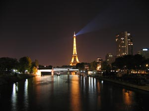 The Eiffel tower and the Seine at night - Paris, France - Photographer: Sami Dalouche
