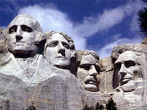 The faces of (left to right) George Washington, Thomas Jefferson, Theodore Roosevelt, and Abraham Lincoln on Mount Rushmore National Memorial, South Dakota, USA